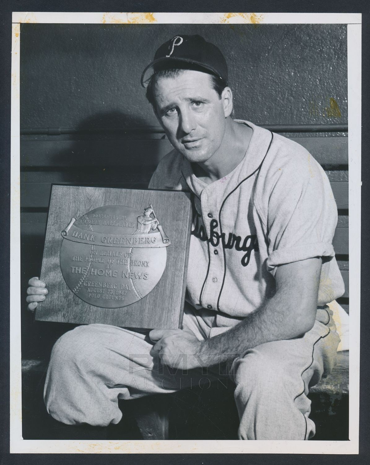 Hank Greenberg poses with plaque during his final MLB season